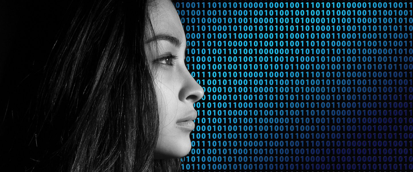 Profile of a woman with binary code in the background