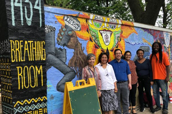 community engagement advisory board members outside a local Chicago nonprofit