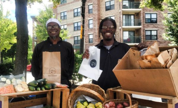 image of Otis farm stand workers at a farmers market