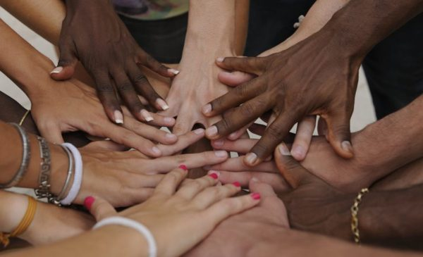 diverse hands stacked in solidarity