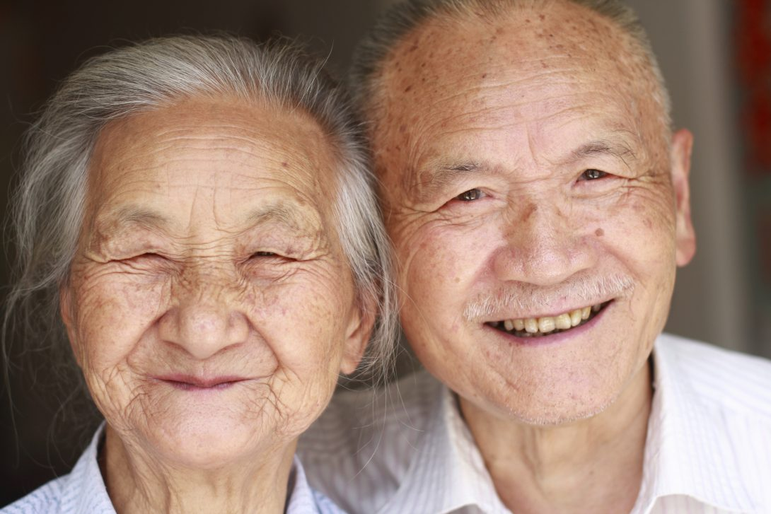 smiling elderly asian couple