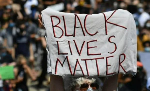 CBS News screenshot from live interview with Dr. Olu Ajilore