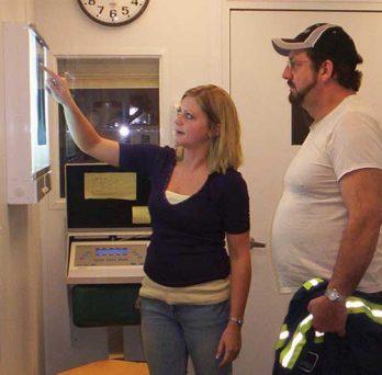 Two people examine an x ray. Photo courtesy of NIOSH