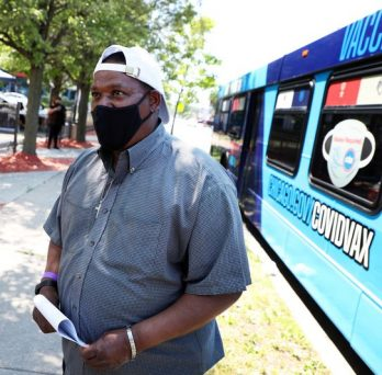 Tony Marshall waits to be vaccinated against COVID-19 at one of the Chicago Department of Public Health's hyper-local vaccination sites, a converted city bus situated at 69th and Sangamon streets in Chicago on June 3, 2021. (Terrence Antonio James / Chicago Tribune)