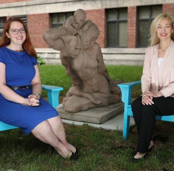 UIC's Jennifer Duffecy and Pauline Maki sit with a sculpture titled