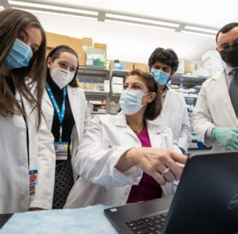 Dr. Nahed Ismail discusses data with her research team in the lab. (Photo: Joshua Clark/University of Illinois Chicago)