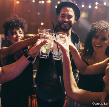 A group of people drinking alcohol, taken by Jacob Lund/Adobe Stock