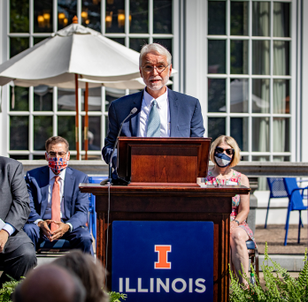 President Tim Killeen speaks at the podium outside the Illini Union at the University of Illinois Urbana-Champaign to present 28 individuals with the Presidential Medallion for their leadership in the U of I System's pandemic response (UI System)
